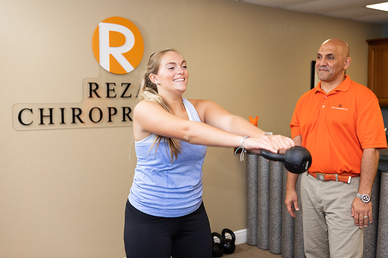 Young lady exercising at chiropractic clinic