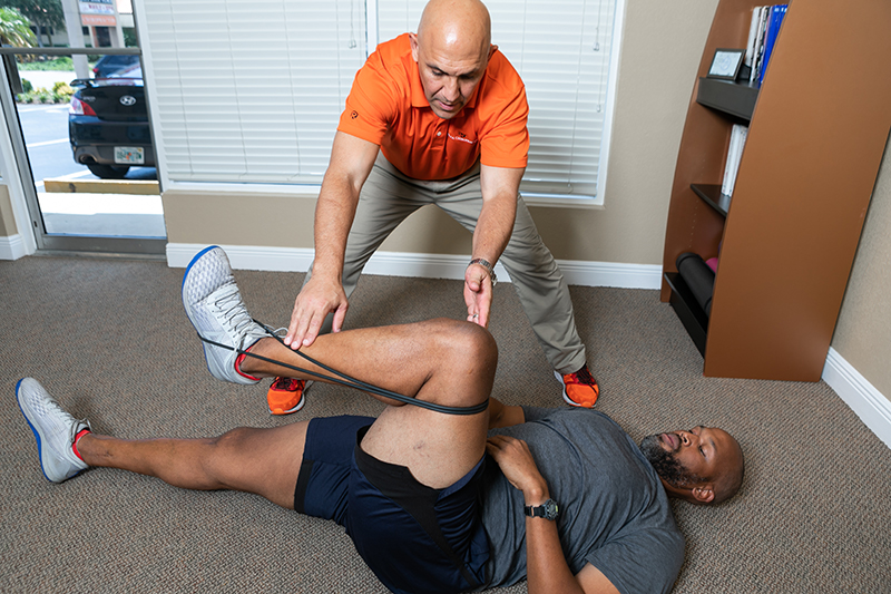 A runner getting chiropractic care at Reza Chiropractic
