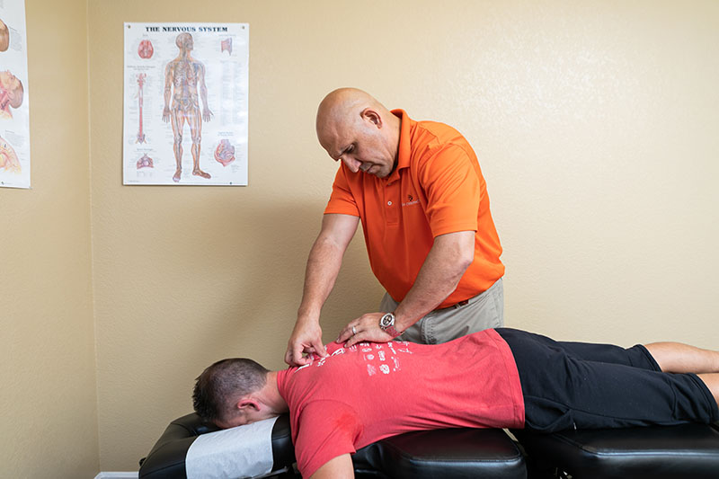 A patient receiving chiropractic care at Reza Chiropractic