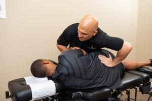 Back adjustment at Reza Chiropractic